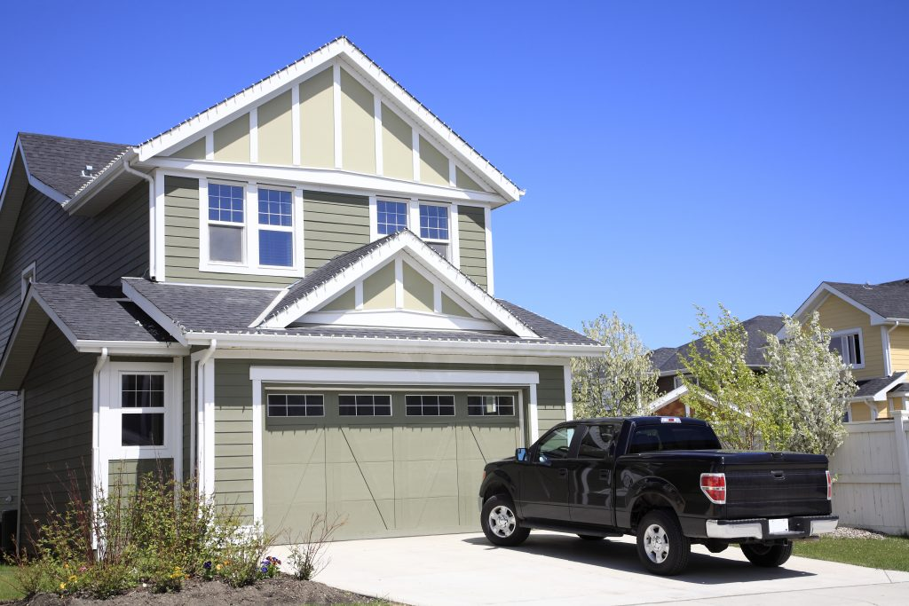 Pickup truck in the driveway of a home for an at-home test drive
