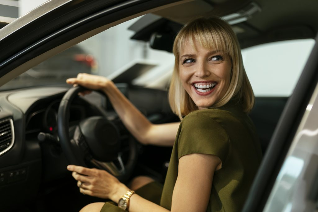 Woman in a car during a test drive from home
