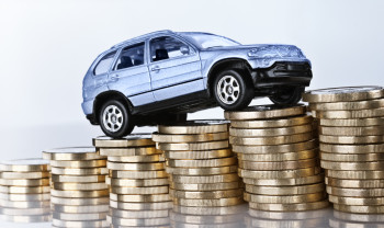 """""""Frankfurt, Hessen, Germany - April 04, 2012: Car drives up a ramp made from coins."""""""